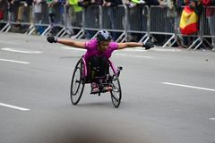 2017 NYC Marathon - Wheelchair Woman. Wheelchair woman in the 2017 NYC Marathon Royalty Free Stock Photography