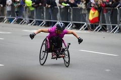 2017 NYC Marathon - Wheelchair Woman. Wheelchair woman in the 2017 NYC Marathon Royalty Free Stock Image