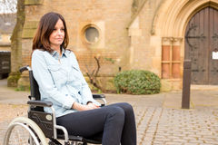 Wheelchair woman. A young woman in a wheelchair looking sad Royalty Free Stock Photos
