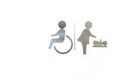 Wheelchair and women with baby, Changing diapers toilet metal si Stock Image