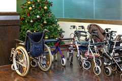Wheelchair for a Xmas tree Royalty Free Stock Photography