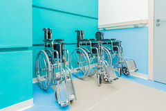 Wheelchairs arranged in the hospital. The wheelchairs arranged in the hospital Royalty Free Stock Photo