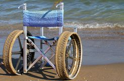 Wheelchairs for disabled people on the beach Royalty Free Stock Image