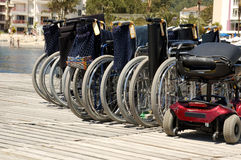Wheelchairs at harbor waiting for passengers Stock Image