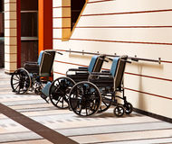 Wheelchairs in the hospital. Three wheelchairs in the hospital royalty free stock photography
