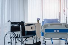 Wheelchairs in hospital room. This vehicle is used to transport patients who can not move or disable to help themselves. Insurance, health problem concepts royalty free stock photography