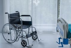 Wheelchairs in hospital room. This vehicle is used to transport patients who can not move or disable to help themselves. Insurance, health problem concepts royalty free stock photo