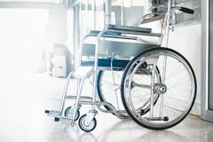 Wheelchairs in the hospital ,Wheelchairs waiting for patient services. with light copy space on left area. Row Wheelchairs in the hospital ,Wheelchairs waiting Royalty Free Stock Photography