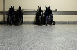 Wheelchairs in the orthopedics department. Wheelchairs closed and parked Royalty Free Stock Photography