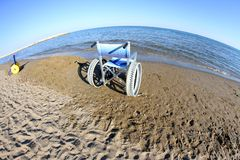 Wheelchairs  with steel wheels on the beach Stock Images