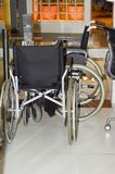 Wheelchairs in the store for sale. No body.  royalty free stock photo