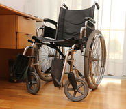 Wheelchairs to disabled people in a bedroom Royalty Free Stock Photos