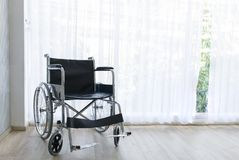 Wheelchairs waiting for services on hospital room with sun light royalty free stock images