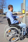 Wheelchairuser on a pedestrian crossing Royalty Free Stock Photography