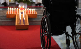 Wheelchari in church. Man in wheelchair in church Royalty Free Stock Image