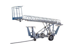 Wheeled articulated boom lift with lattice boom and basket. Wheeled in tow articulated boom lift with manual lifting lattice boom and basket on a light Royalty Free Stock Image