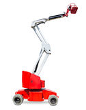 Wheeled articulated boom lift on a light background Stock Photography