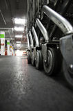 Wheeled cart in the mall. Wheel with the road surface as a backdrop Royalty Free Stock Photo