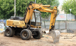 Wheeled excavator on ground Royalty Free Stock Image