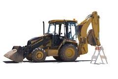 Wheeled excavator performs maintenance work. Wheeled excavator performs repair work. White background Stock Images