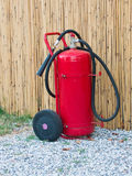 Wheeled fire extinguisher outdoor Stock Photos