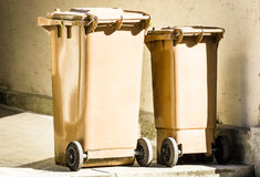 Wheeled garbage cans. Two wheeled garbage cans at a sidewalk in austria Stock Image