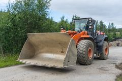 Wheeled loader with a large scoop. Use in construction to move aside or load bulk materials Stock Photo