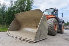 Wheeled loader with a large scoop. Use in construction to move aside or load bulk materials Royalty Free Stock Image
