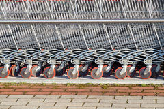 Wheeled shopping trolley. In a row stock images