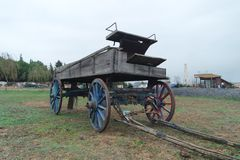 An old horse carriage on the grass royalty free stock photography