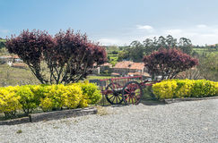 Wheeled wagon. Parked in the area between two trees with purple leaves in the background are houses Santillana del Mar Royalty Free Stock Photos