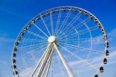Wheeler. Distant Ferris wheel photograph taken against a clear blue sky Stock Photography