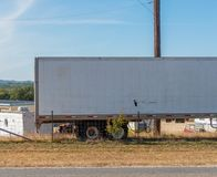 18 wheeler big rig parked on side of rural road with space for type stock photography