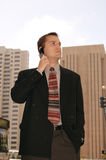 Wheeler Dealer. Business executive on a cell phone outside in the heart of the city Stock Images