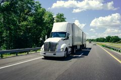 18 wheeler semi-truck on highway road beautiful day royalty free stock photos