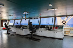 Wheelhouse control board of modern industry ship approaching to Stock Photography