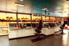 Wheelhouse control board of modern industry ship approaching to Royalty Free Stock Images