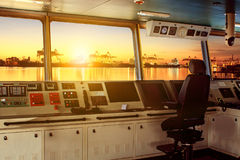 Wheelhouse control board of modern industry ship approaching to. Harbor at night Royalty Free Stock Photo