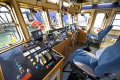 The wheelhouse of a fire boat stock image