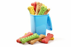 Wheelie bin and dog biscuits Stock Photo