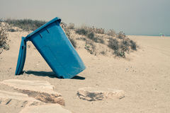 Wheelie bin on sandy coast Stock Photos