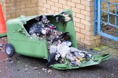 Free Wheelie Bin Vandalism On Side Burnt Out By Fire By Vandals In Council Estate London Arson Attack Royalty Free Stock Photos - 176949058