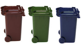 Wheelie bins. Shot of three bins used for recycling on white Stock Images
