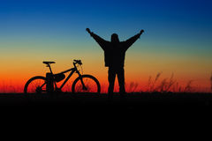 Wheelman silhouette with cycle Royalty Free Stock Image
