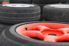 Wheels. Image of a heap of race car wheels. Slective focus on the tyre valve Royalty Free Stock Images
