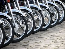 Wheels. Row of new motorcycle wheels Royalty Free Stock Image