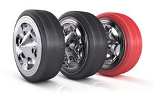 Wheels. Two black wheels and one red wheel on white background. 3d render Stock Image