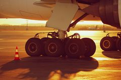 Wheels of the airplane at the sunset Royalty Free Stock Photography