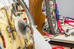 Wheels and bicycle parts over workshop table Stock Images