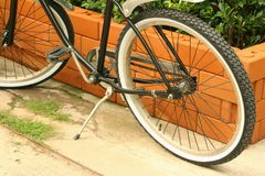 The wheels of bicycles parked at the park. Royalty Free Stock Photos